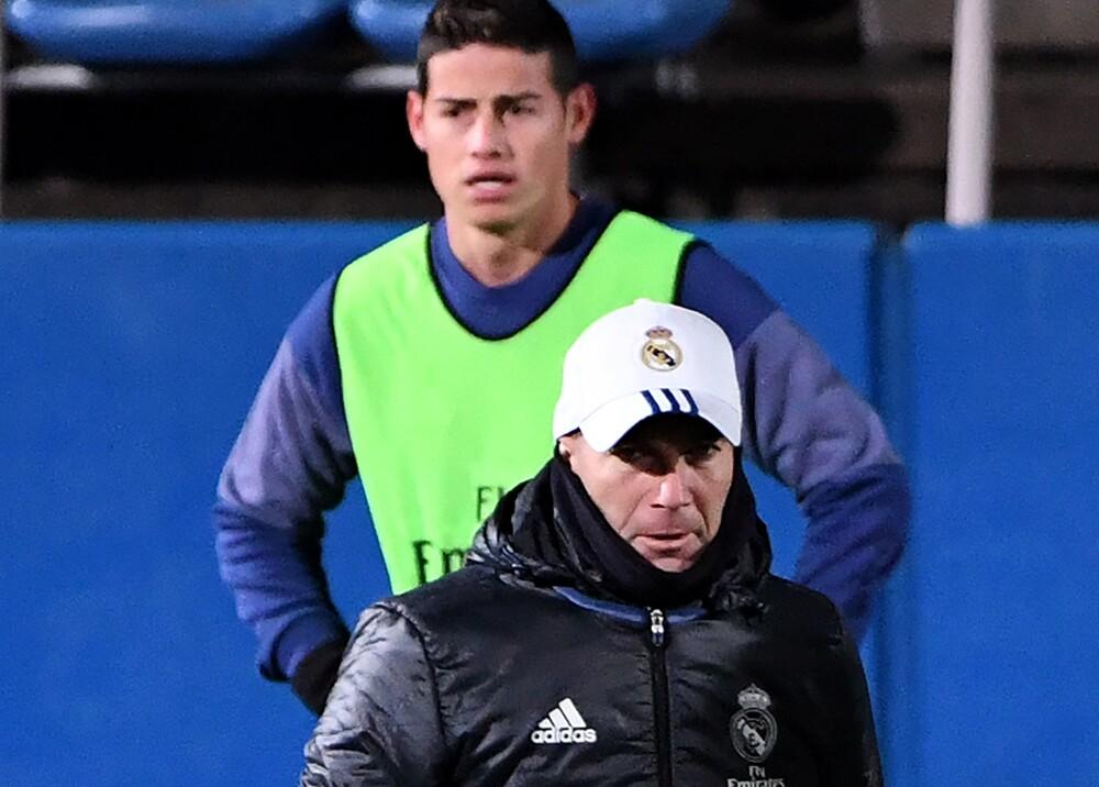 347934_James y Zidane - Foto AFP