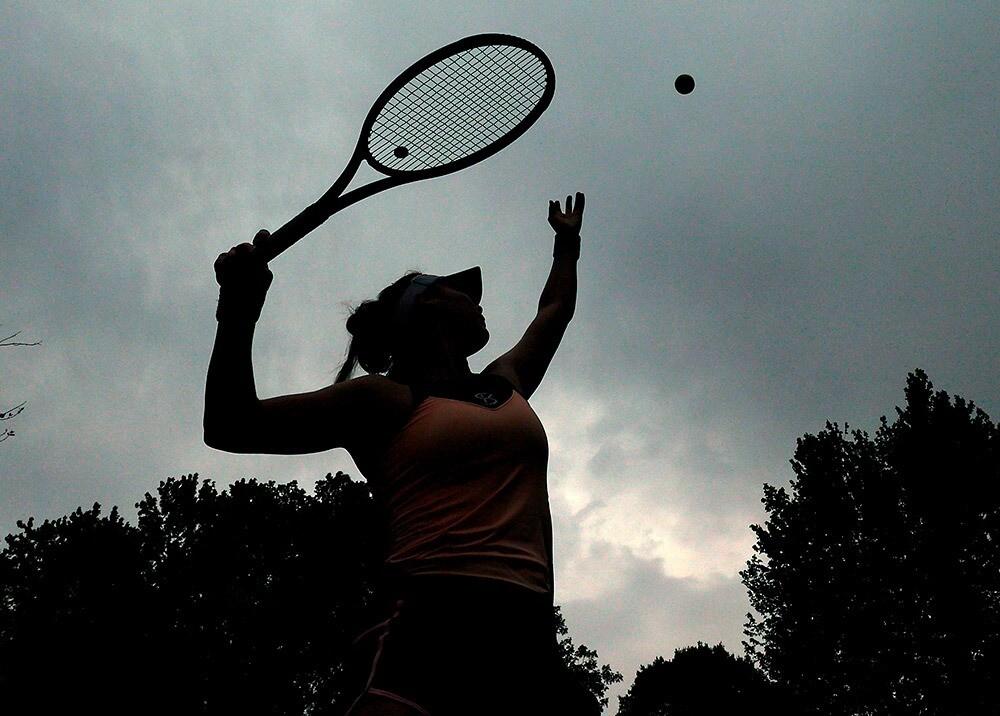 367966_Práctica del tenis // Foto: AFP