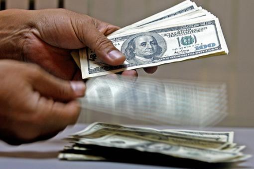 24110_BLU. Dolar Americano/ Foto: AFP