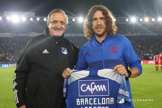 332072_Enrique Camacho y Carles Puyol