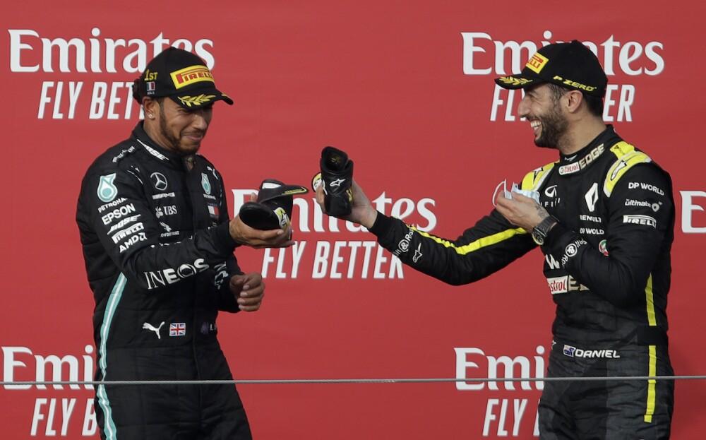 Hamilton y Ricciardo / AFP