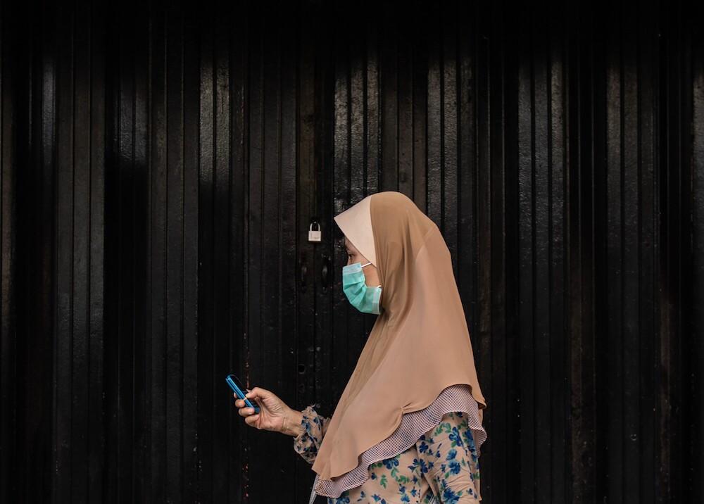 359398_Mujer en Malasia / Foto: AFP
