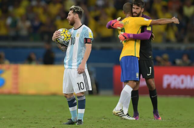316207_Messi y Alisson