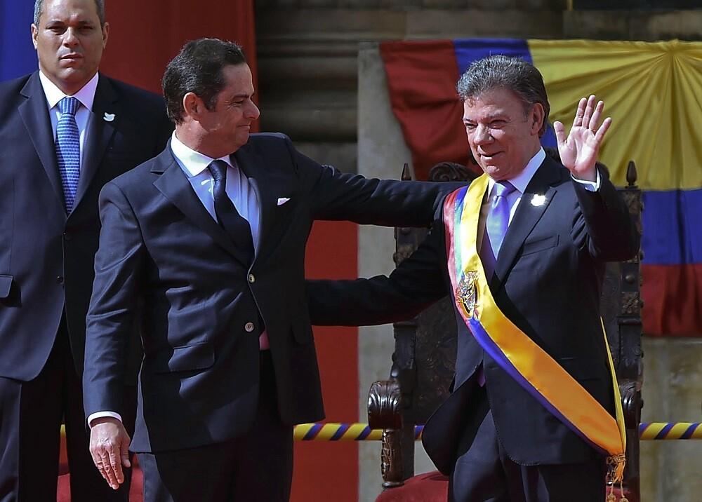 336562_BLU Radio. Germán Vargas Lleras y Juan Manuel Santos // Foto: AFP