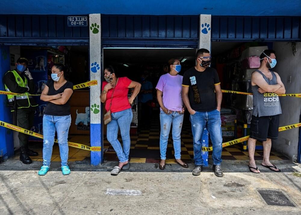 367593_Pico y cédula. Foto: AFP