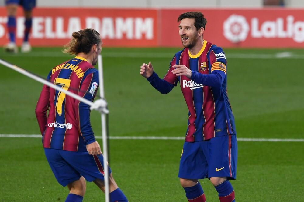 Griezmann y Messi / AFP