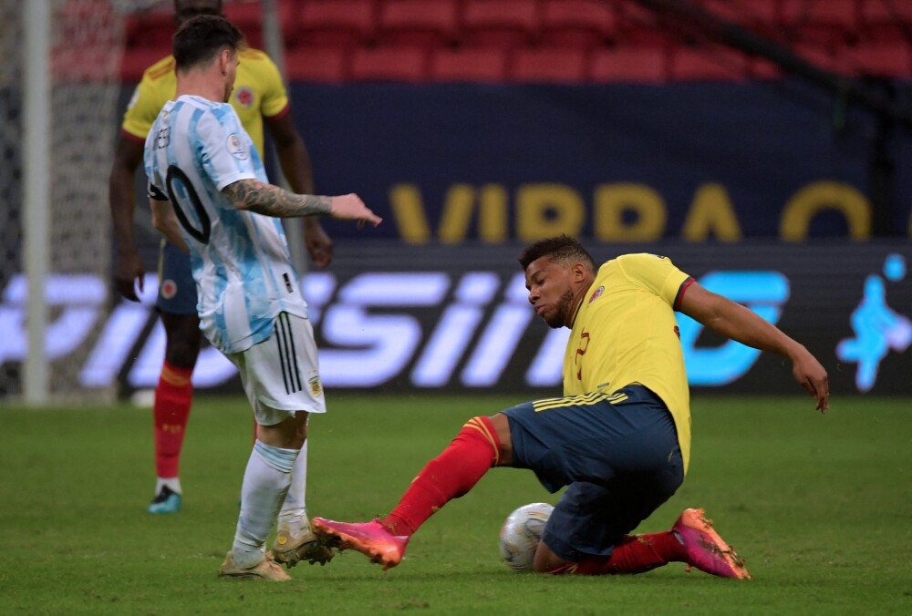 Lionel Messi y Frank Fabra