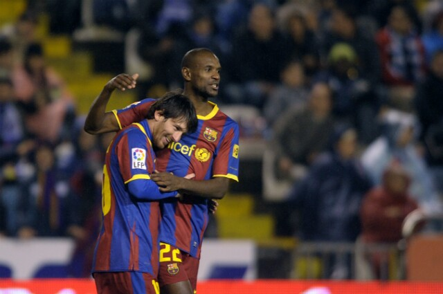 Eric Abidal y Lionel Messi
