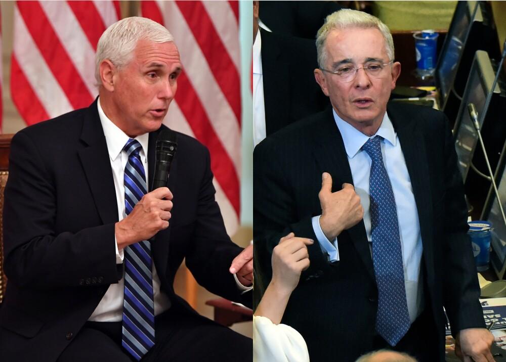 374342_Mike Pence y Álvaro Uribe / AFP