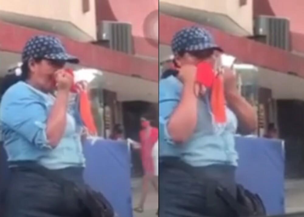 25732_Mujer se limpia la nariz con los tapabocas que vende-Fotocaptura YouTube