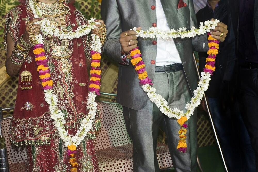 Groom and Bride holding jaimala in wedding, Uttar Pradesh, India, Asia