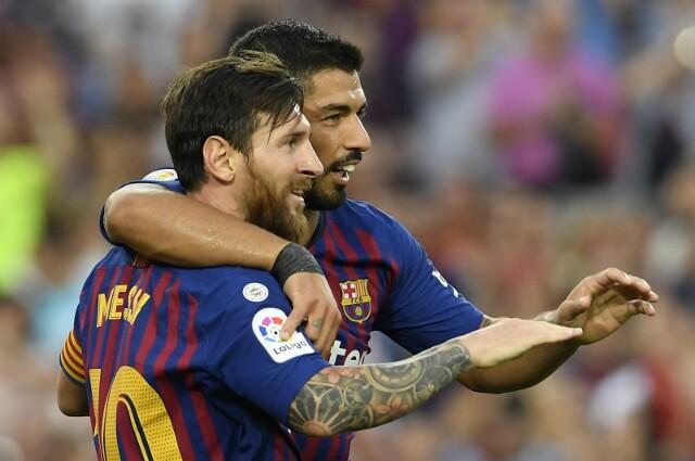Lionel Messi y Luis Suárez.