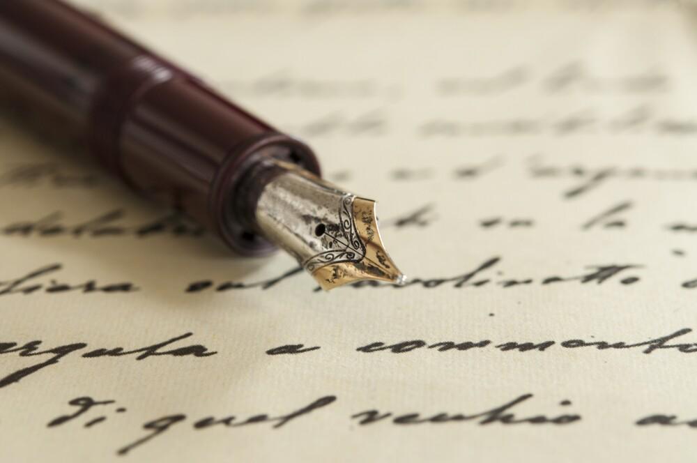 old fountain pen on manuscript