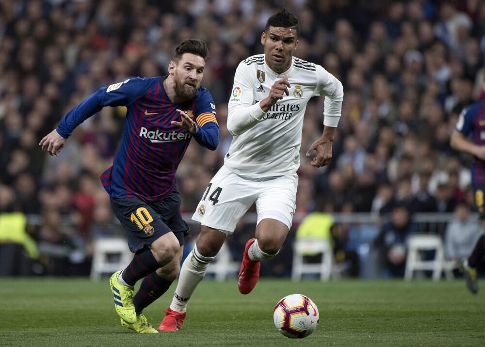 346183_Messi y Casemiro // Foto: AFP