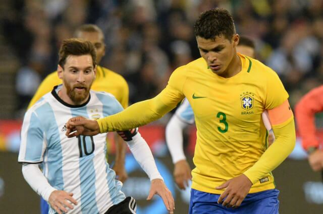 316195_Messi y Thiago Silva
