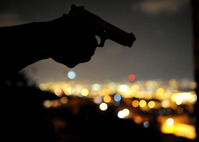 360874_Pistola. Foto: Referencia AFP