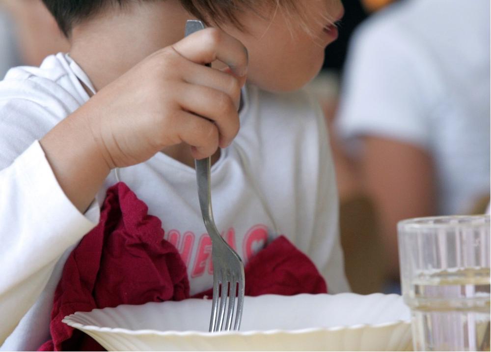 316010_BLU Radio. Niños alimentandose /Foto: AFP