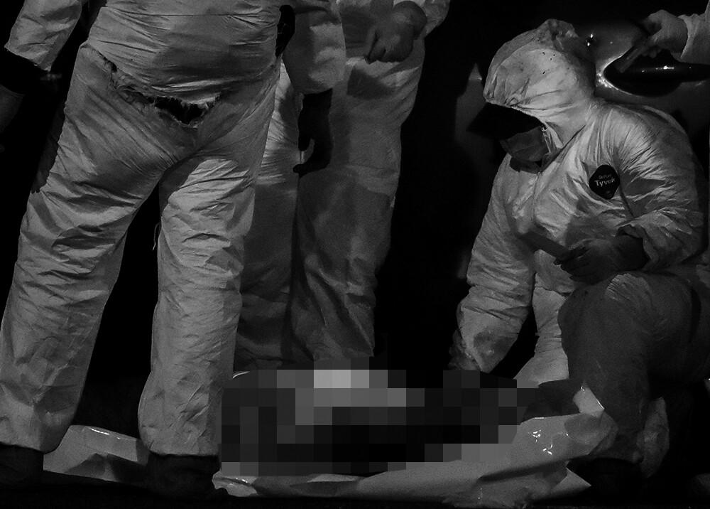 374405_Levantamiento de cadáver // Foto: AFP, imagen de referencia