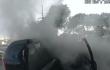 rescate de un hombre de un auto en llamas.png