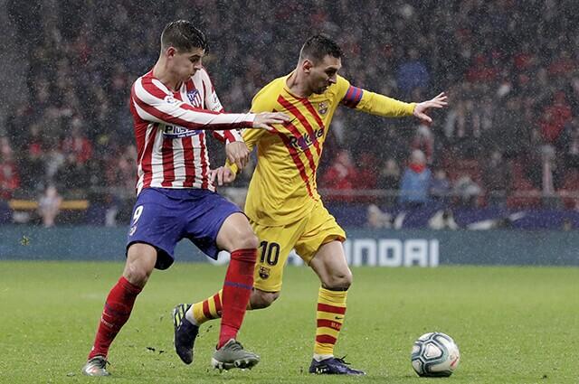 328213_messi_barcelona_atletico_080120_rico_brouwe_getty_e.jpg