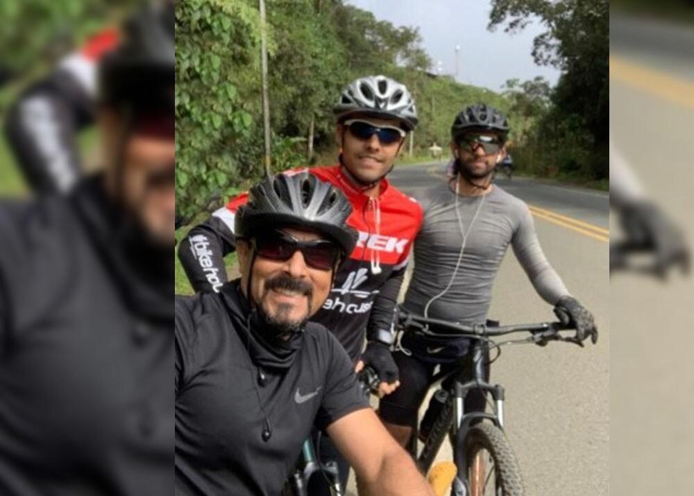 ciclistas atracados en el cerro tres cruces de cali.jpg