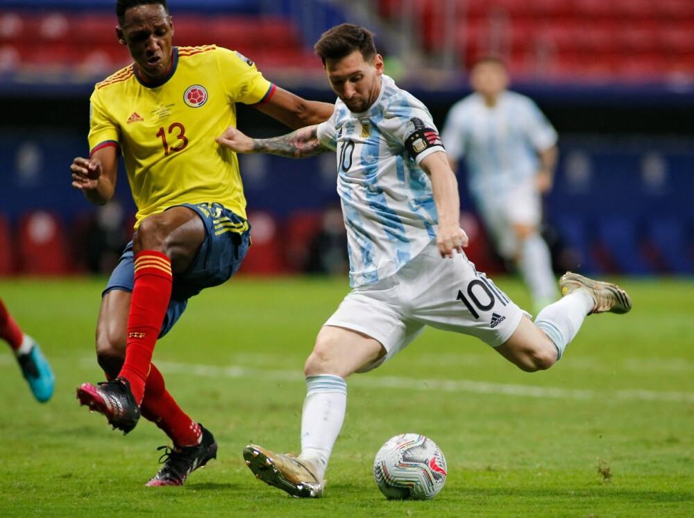 Messi Yerry Mina aFp.jpeg