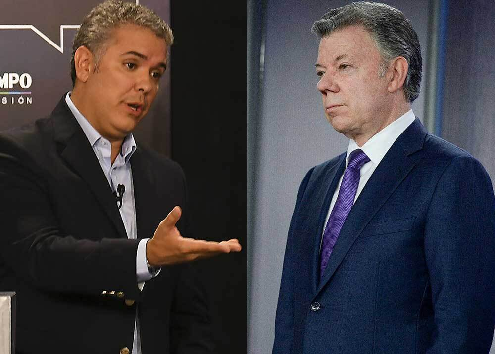 Iván Duque y Juan Manuel Santos // AFP