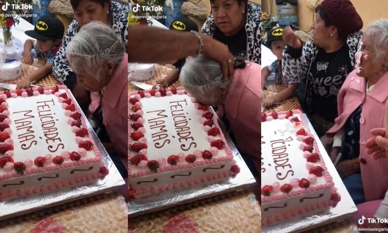 Mujer es empujada contra su pastel.