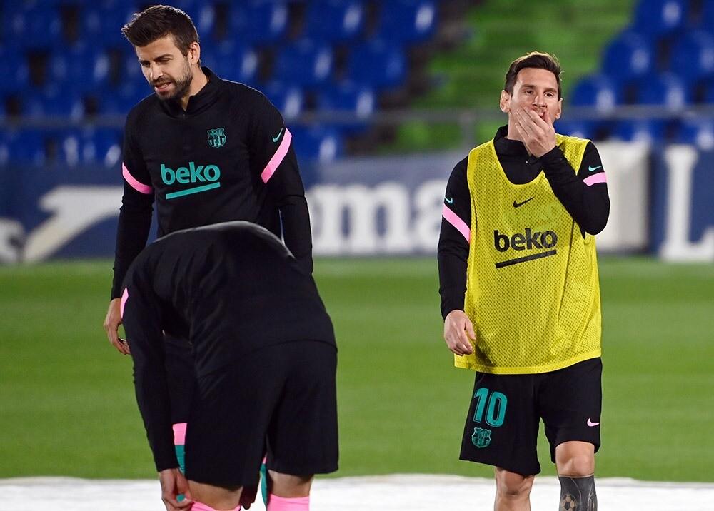 Gerard Piqué y Lionel Messi : AFP.jpeg