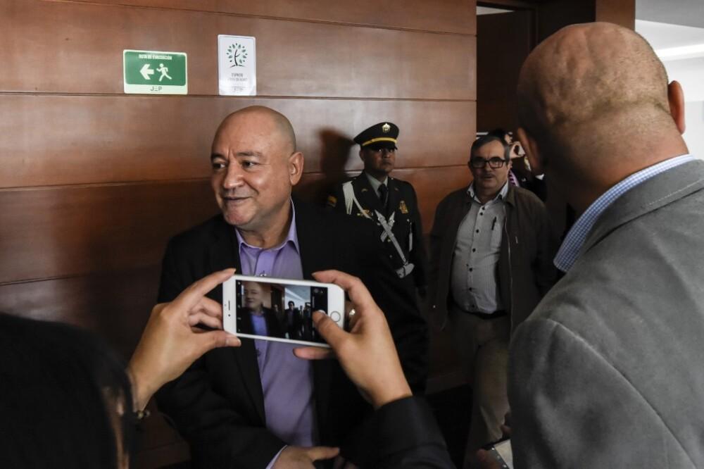 Carlos Lozada y Rodrigo Londoño Echeverri ante la JEP Foto AFP, archivo.jpeg